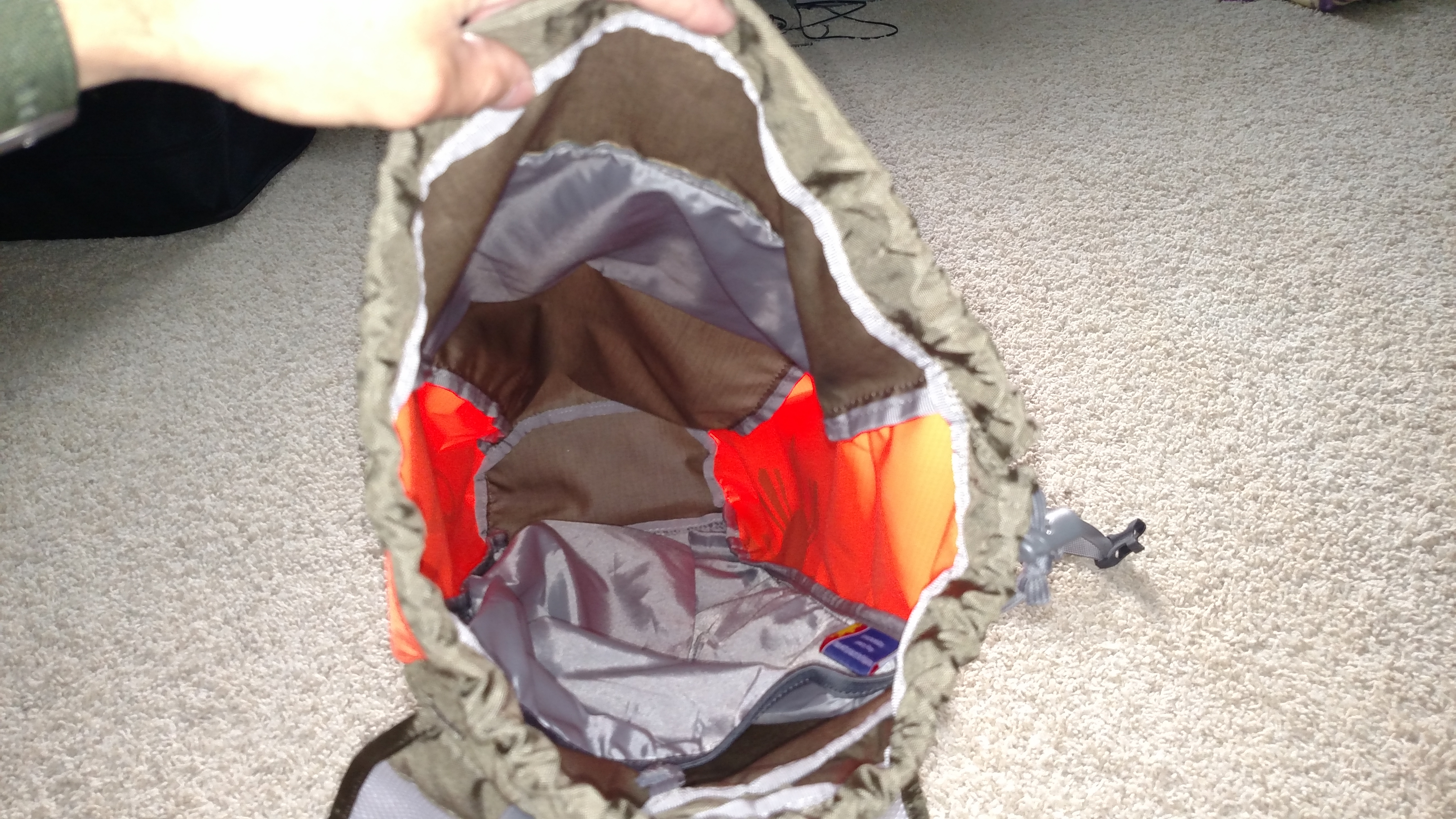 The main compartment and pouch for the hydration bladder.
