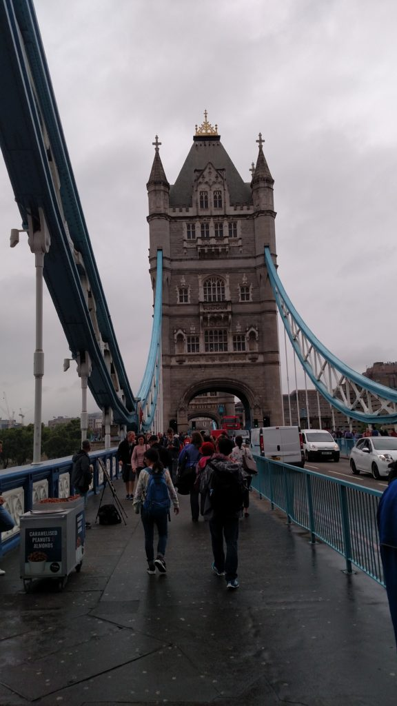Crossing Tower Bridge while walking London