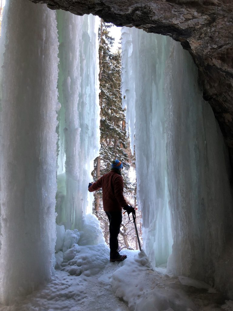 Looking out from behind the ice wall at Community Caves in winter