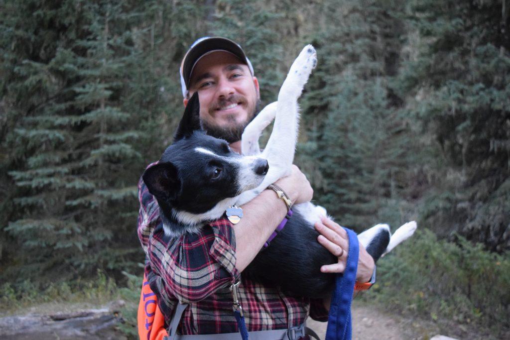 Wade holding dog wondering if hes a bad dog owner