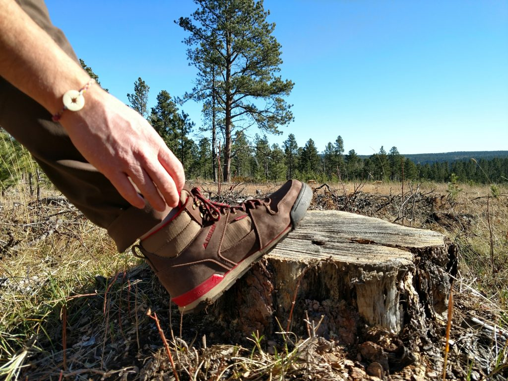 Monty Hi boot on a stump, a great outdoor gift